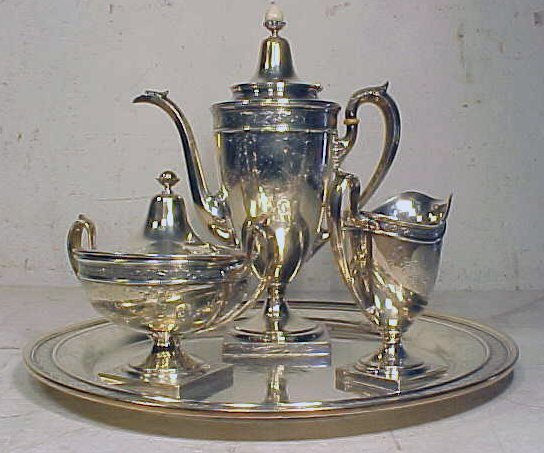 Silver tea 4 piece tea set, J.E. Caldwell & Co