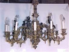 Ornate bronze Gothic Revival chandelier with cherubs