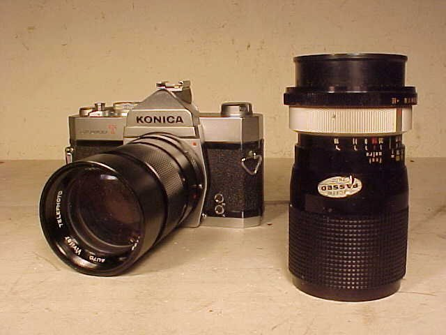 Konica T auto reflex camera with extra lenses.