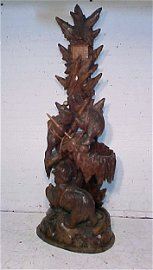 Heavily carved black forest hall tree