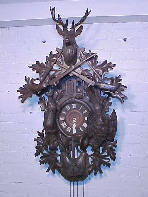 Cuckoo clock, carved deer & birds