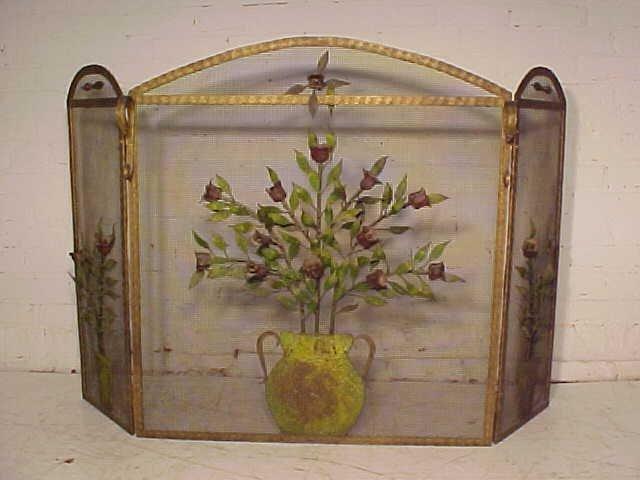 Folk art fire screen with applied metal flowers