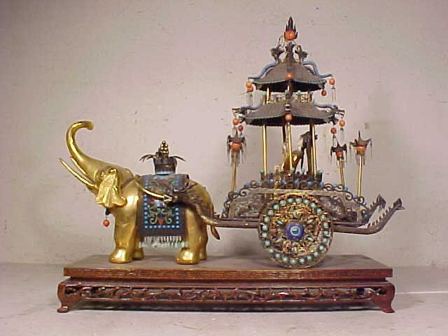 Silver enameled elephant drawn carriage with figure