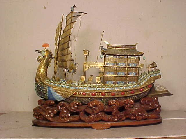 Silver enameled boat with bird shape front