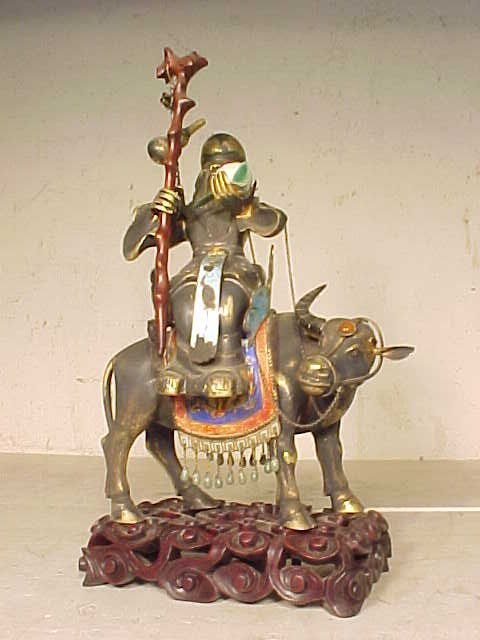 Chinese silver enameled figure on cow