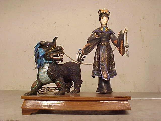 Silver enamel figure holding foo dog on leash