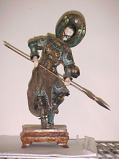 Silver enamel figure with spear