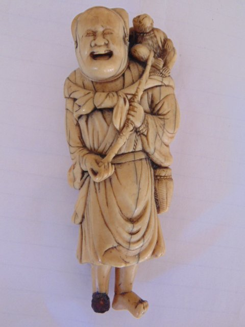 18th century Netsuke, man with monkey