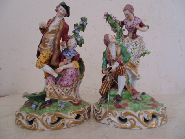 Pair Geramn porcelain figurines, 10""