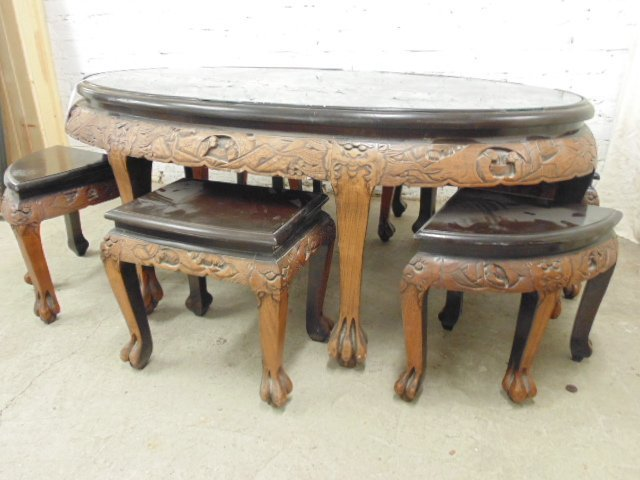 Elaborately carved Asian oval coffee table with 6