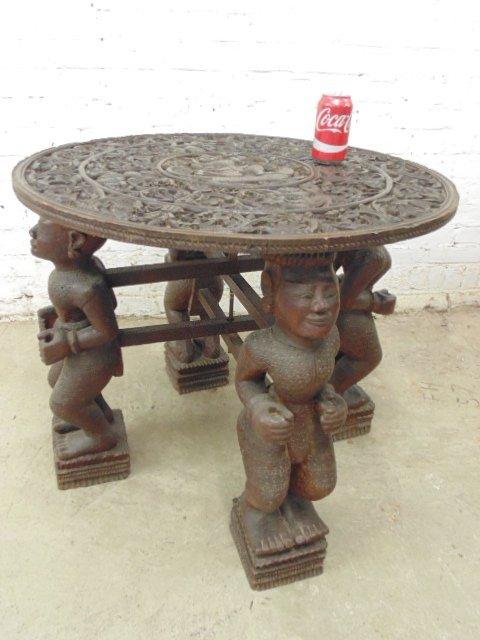 Carved figural folding base Asian side table