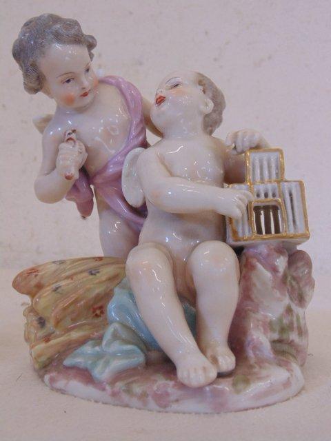 Meissen figurine, 2 putti's with bird, birdcage