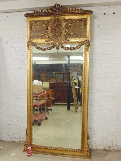Large carved gilt framed trumeau mirror