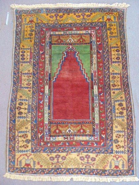 Prayer rug, red & green center, beige border.