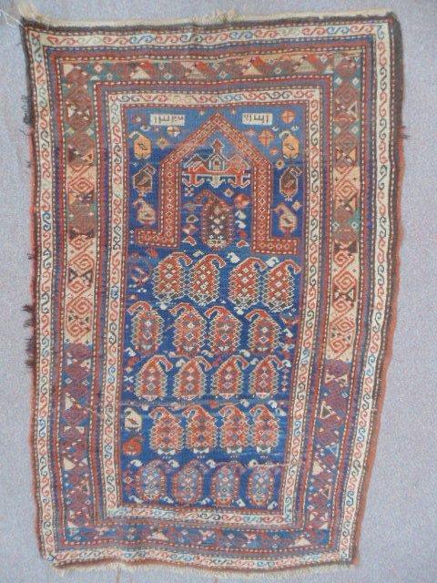 "Prayer rug, blue & red, some wear, 59"" by 39""."