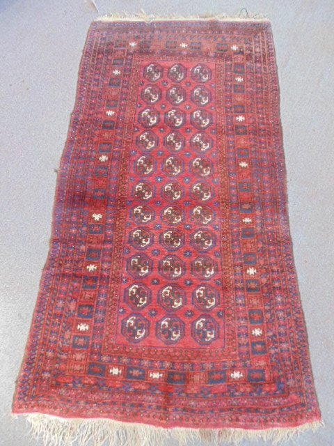 """Carpet, Bokhara, red & blue, 85"""" by 45""""."""