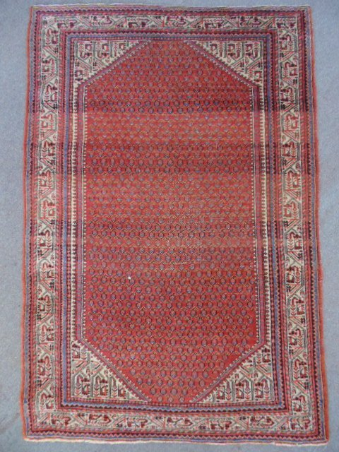 """Carpet, red, pattern center, 59"""" by 40""""."""