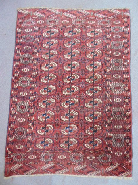 "Early Bokhara carpet, 63"" by 45.5""."
