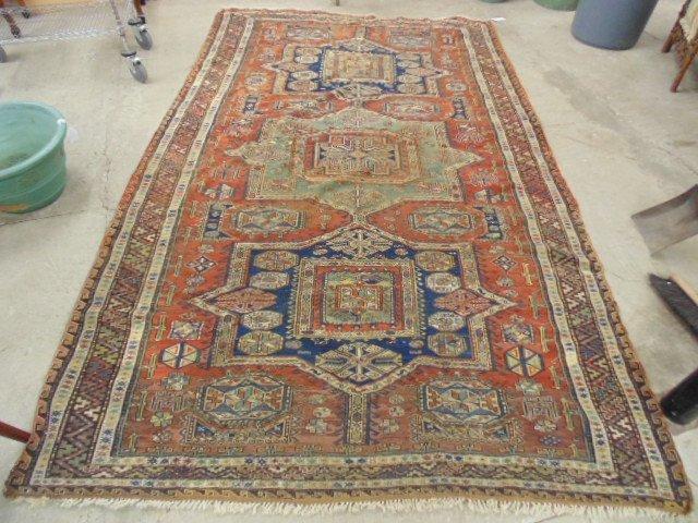 """Oriental carpet, some wear, 10'6"""" by 6'7""""."""