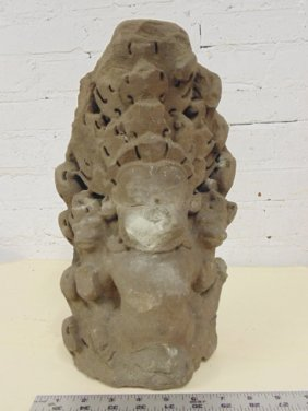 Stone carving, figure with headdress, Asian