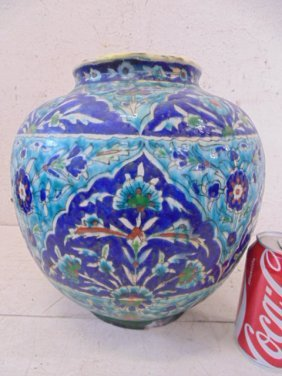 Persian urn,  blue floral decorations