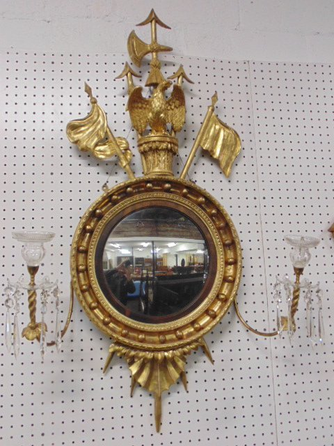 Gilt girandole mirror with eagle, flags and crystal