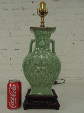 Chinese Celadon vase, wood base, bronze top trim