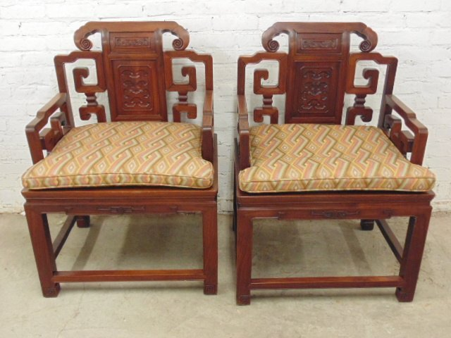 Pair of carved rosewood Chinese arm chairs