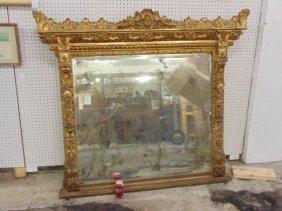 Large ornately carved & gilt beveled mirror