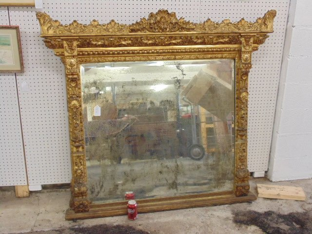 Large ornately carved & gilt beveled mirror