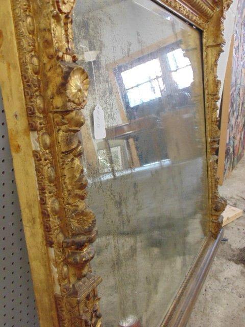 Large ornately carved & gilt beveled mirror - 6