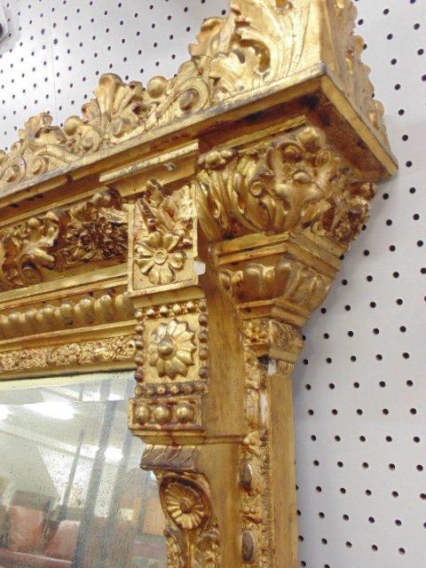 Large ornately carved & gilt beveled mirror - 7