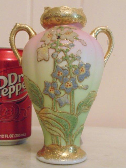 Coralene porcelain vase; gilt and floral decoration