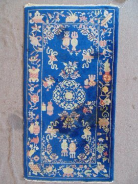 Small Chinese scatter rug, blue, with designs