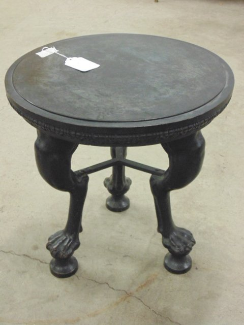Bronze stool, three claw footed legs