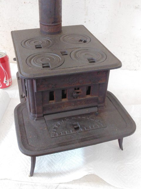 """The Doll"" toy cast iron cook stove"