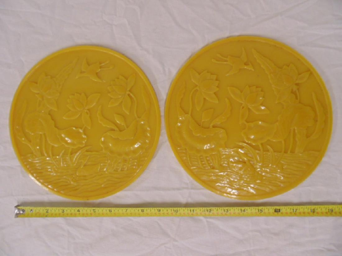 Pair yellow Peking glass round plaques