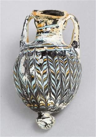 An Eastern Mediterranean core form glass amphoriskos