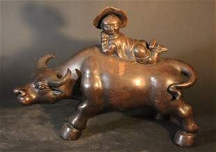 Chinese sculpture of a water buffalo with young boy