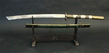 Chinese sword with lightly bowed damascene blade with
