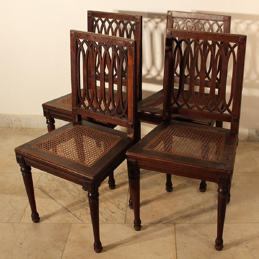 A set of four Louis XVI dining chairs