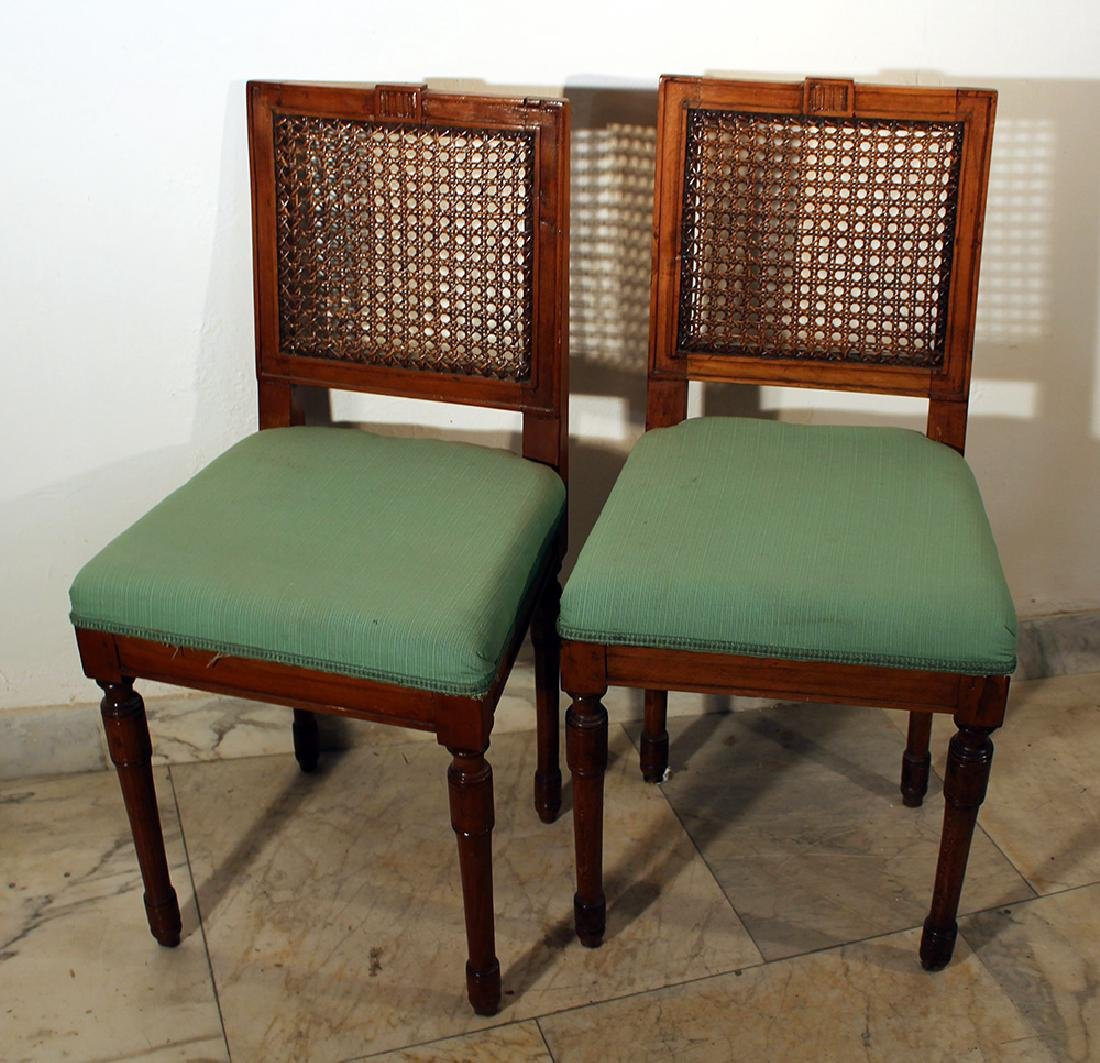 A pair of Louis XVI dining chairs