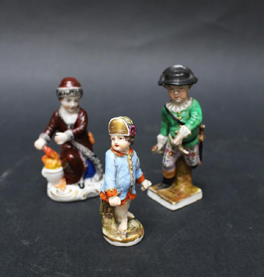 Lot of three porcelain figures