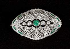 Diamond emerald brooche around 1920