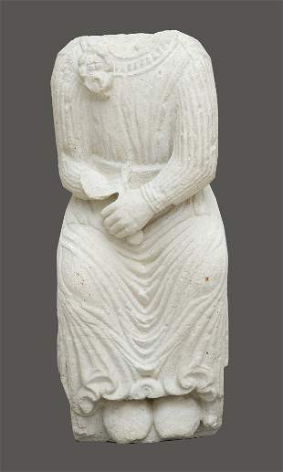 Torso of a sitting male sculpture