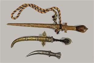 Three oriental daggers