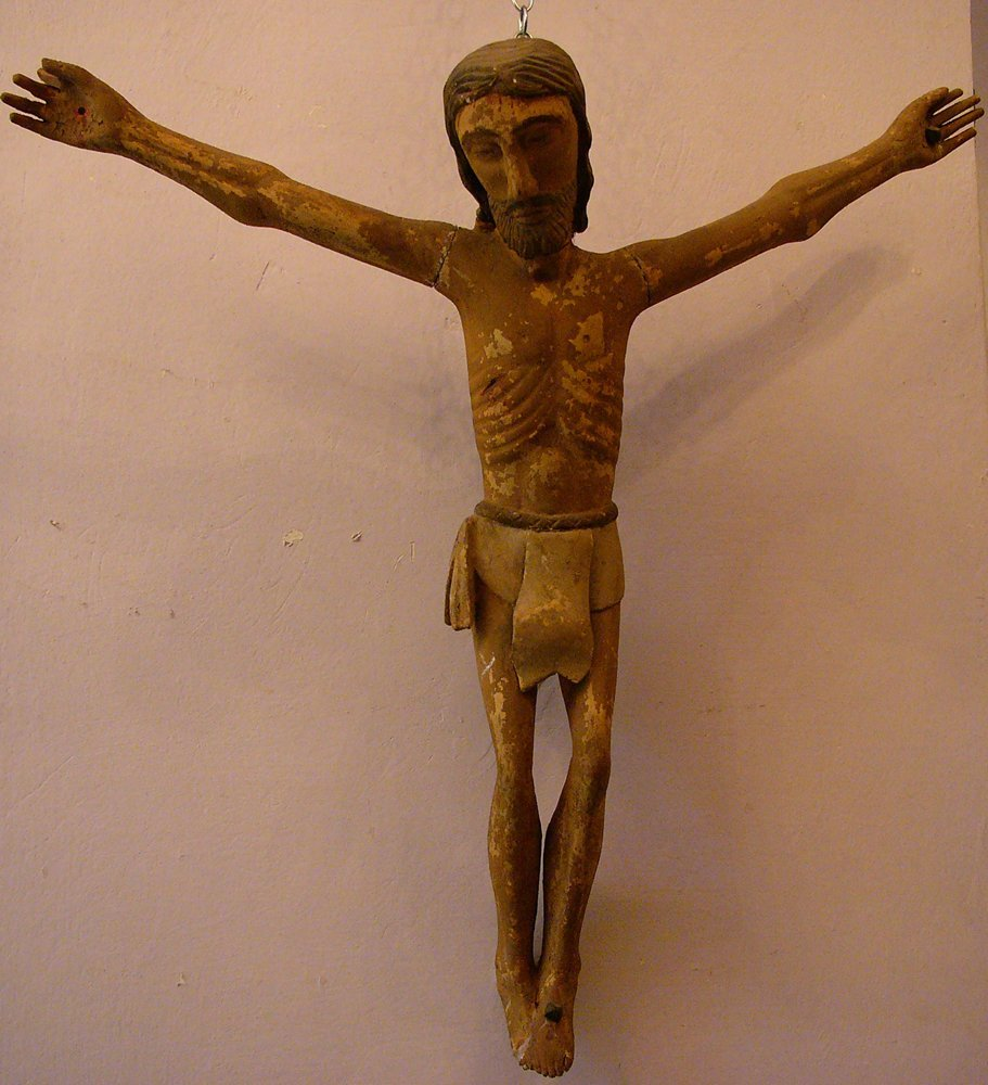 Jesus crucified in Romanic style, wood carved with orig