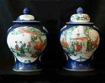 Pair of porcelain vases in Kangxi style, in baluster