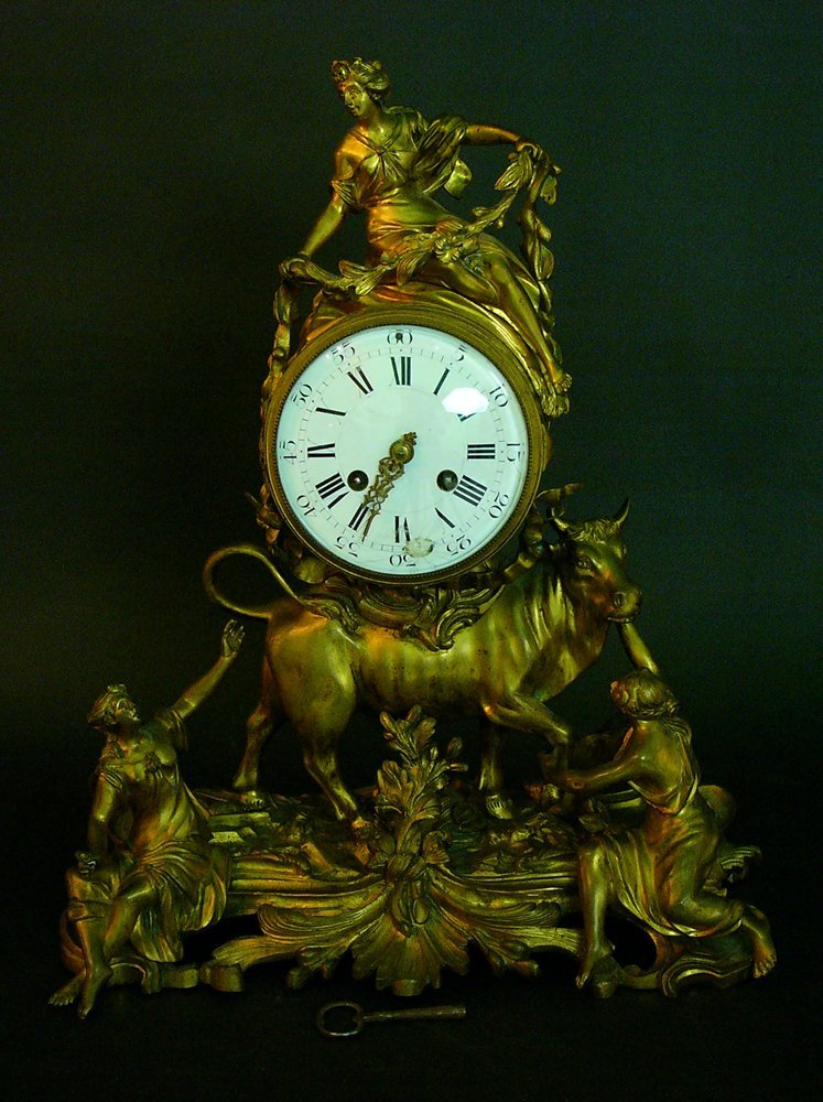French Ormulu Clock in Baroque style, Bronze cast