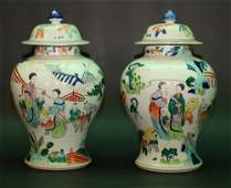 Pair of Chinese porcelain vases with lids,